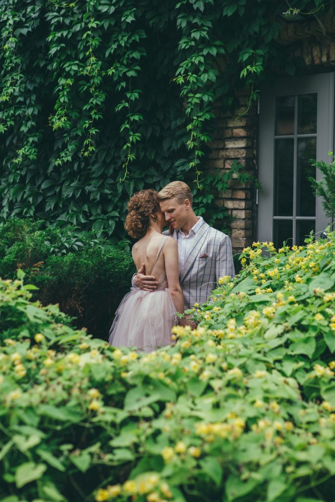 Gentle wedding picture among the flowers. Sensual photography.